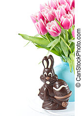 chocolate easter bunny and pink tulip flowers
