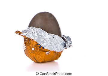 chocolate easter egg - partly unwrapped chocolated easter...