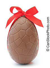 Chocolate easter egg with decorative red ribbon