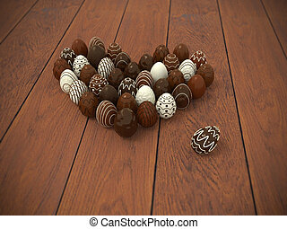 Chocolate Easter eggs heart on brown wooden floor -...