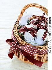chocolate Easter eggs in basket, food closeup