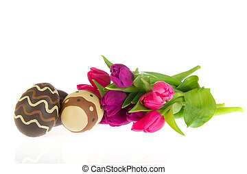 Chocolate easter eggs with tulips