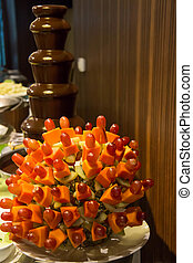 Chocolate fountain and mixed fruit skewer
