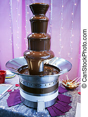 Chocolate Fountain - Melting chocolate flows down the tiers...