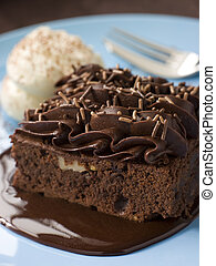 Chocolate Fudge Brownie With Chocolate Fudge Sauce And Cream