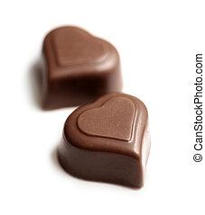 Chocolate hearts - Heart-shaped chocolates. Short depth-of-...