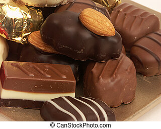 Chocolate Heaven - A golden dish piled with an assortment of...