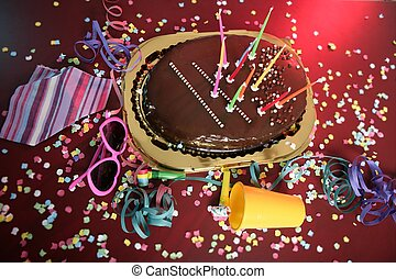 Chocolate holiday party cake on a messy table