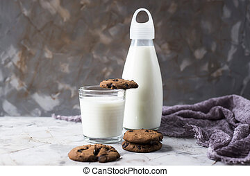 Chocolate homemade cookies with milk on a gray table