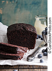 Chocolate loaf cake sliced decorated with frosting and ...