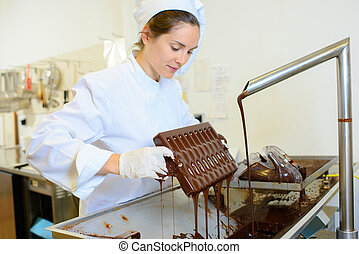 Chocolate maker at work