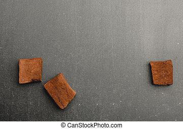 chocolate marshmallows on dark background