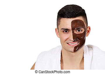 Chocolate mask for men - Man in towel with a mask on his...