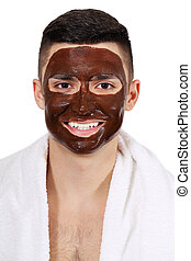 Chocolate mask on the man's face - Man in towel with a mask...