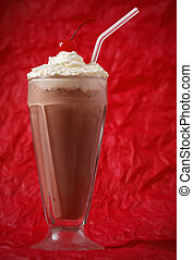 chocolate milkshake with whipped cream and cherry on the...