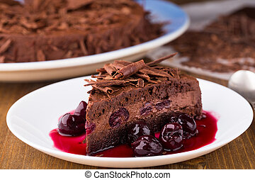 Chocolate mousse cake with dark cherries