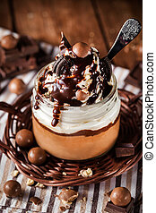 Chocolate mousse decorated with whipped cream