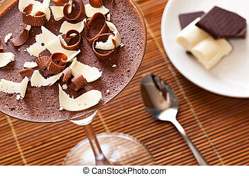 Chocolate mousse dessert on dining table
