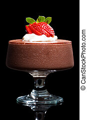 Chocolate mousse dessert with strawberries and cream. ...