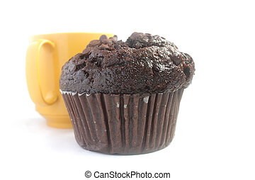 Chocolate muffin and a yellow cup of tea isolated on white background