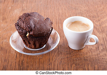 chocolate muffin with a cup of coffee