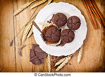 Chocolate muffins on white plate