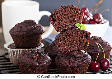 Chocolate muffins with cherry and chocolate drops