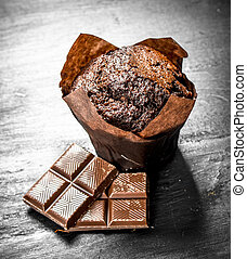 Chocolate muffins with chunks of chocolate.