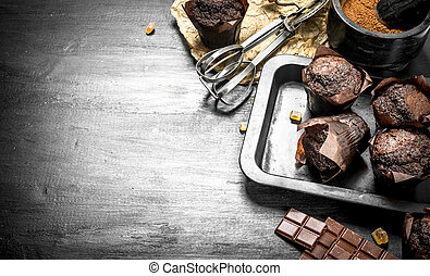 Chocolate muffins with ingredients.