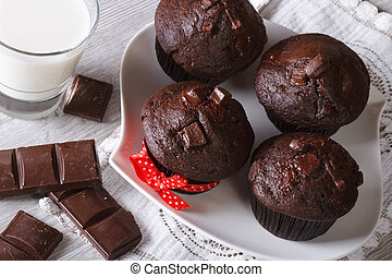 Chocolate muffins with milk horizontal top view