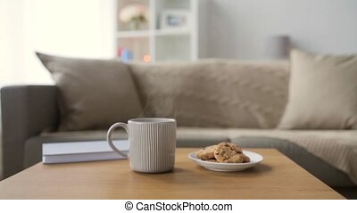 chocolate oatmeal cookies and mug with hot drink - cozy home...