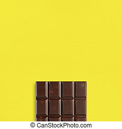 Chocolate on yellow table top view