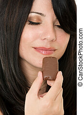 Chocolate Passion - Woman holding a piece of chocolate...