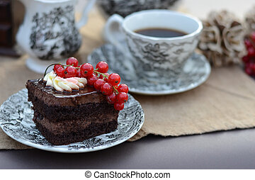 Chocolate pastry with fresh fruit served with a cup of coffee