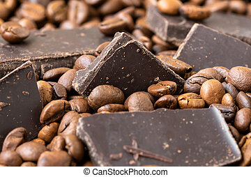 Chocolate pieces in roasted coffee beans