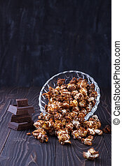 Chocolate pop corn - Closeup of sweet chocolate popcorn in a...