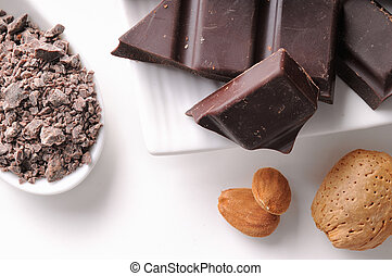 Chocolate portions with almonds on a dish close up