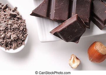Chocolate portions with hazelnuts on a dish close up