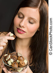 Chocolate - portrait young healthy woman eat candy