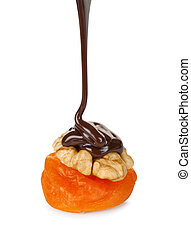 chocolate pouring on walnut and apricots isolated on white backg