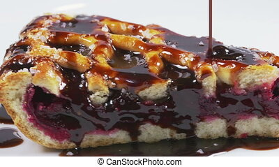 Chocolate pouring over a cherry pie