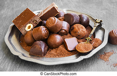 Chocolate pralines assortment with cocoa powder, sweet and tasty dessert