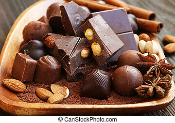 Chocolate pralines and tablet with cocoa, nuts and anise