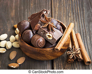 Chocolate pralines assortment with pistachio, almonds and anise