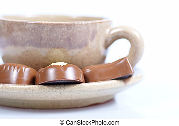 chocolate pralines cup with black coffee on white