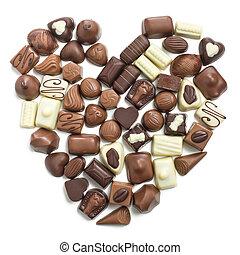 chocolate pralines heart on white background