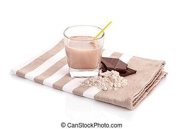 Chocolate protein shake with powder.