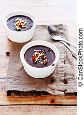 chocolate pudding with nuts, food closeup