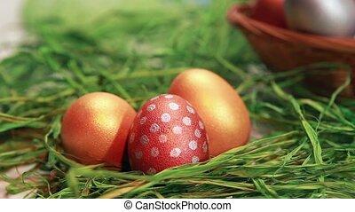 Chocolate rabbit among Easter eggs. Crane Shot
