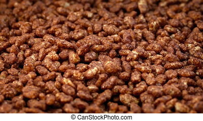 Chocolate Rice Puff Cereal Rotating Closeup - Chocolate rice...